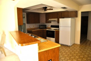 Low ceilings, outdated cabinets, and fake wood countertops, oh my!
