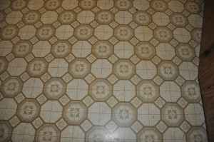 Closer look at the 'retro' linoleum floors. My husband joked we should keep them. Um, no thanks!