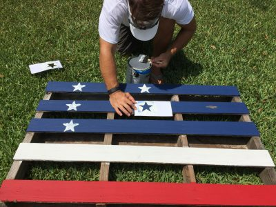 Adding stars to our pallet flag fence